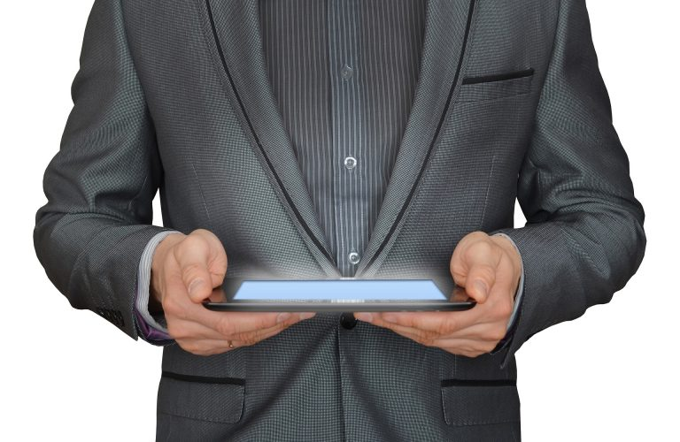 Man witha a tablet or iPad